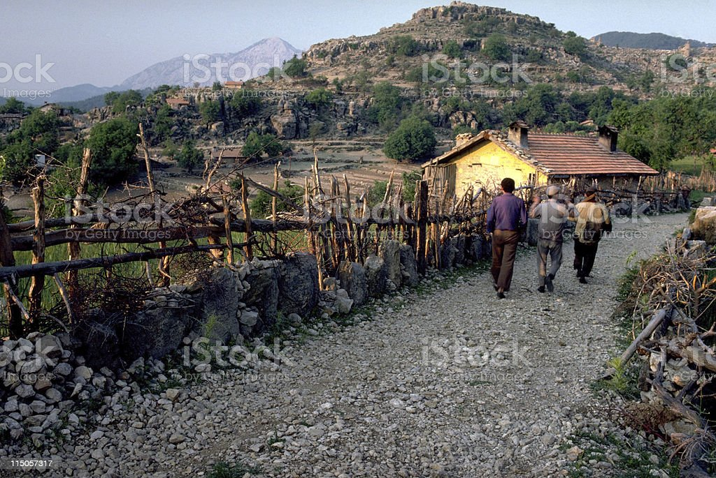 Villagers going to work stock photo
