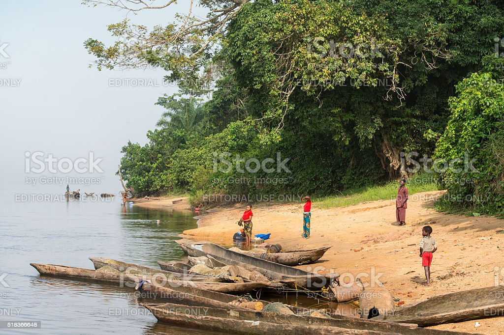 Villagers on the shoreline of Congo River stock photo