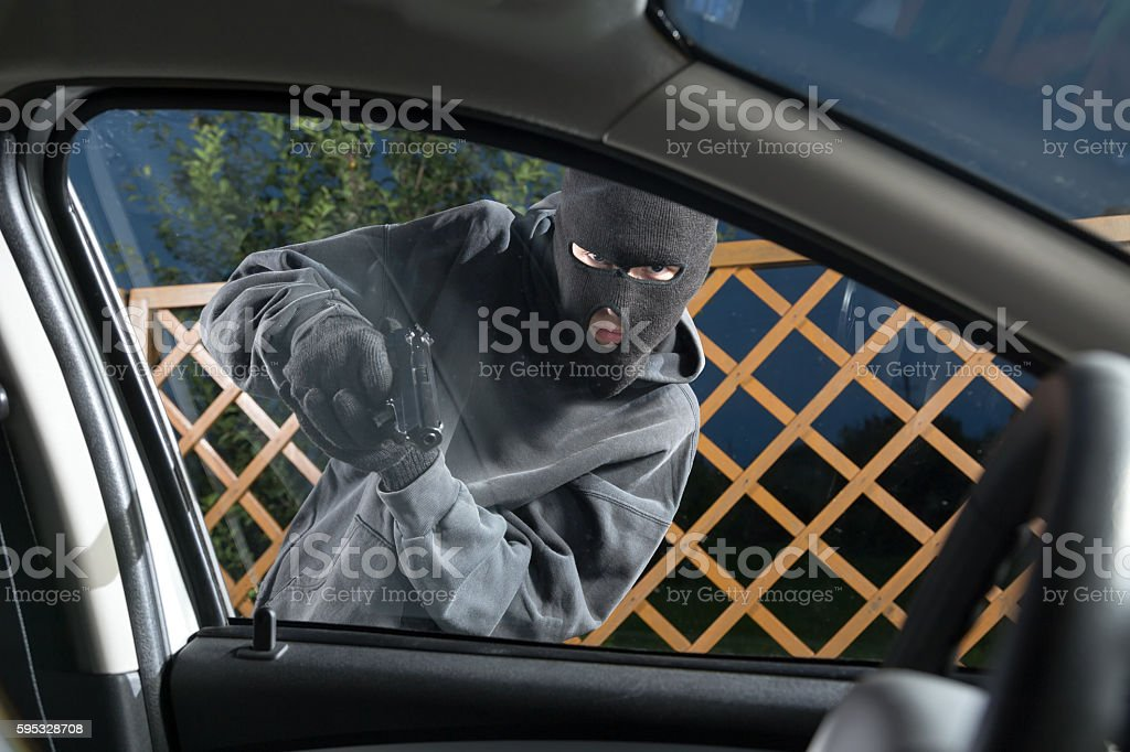 Villain with a gun threatened driver stock photo