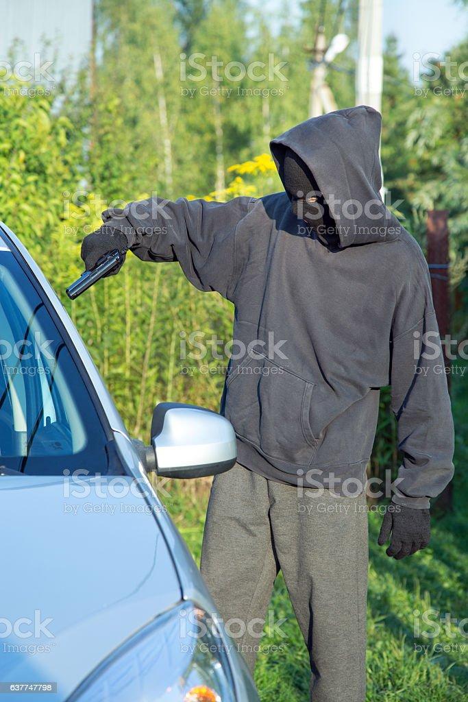 Villain with a gun threatened driver stock photo