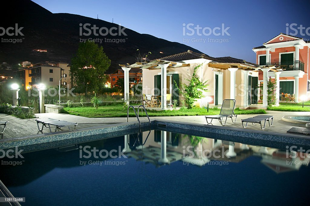 Villas with swimming pool at night royalty-free stock photo
