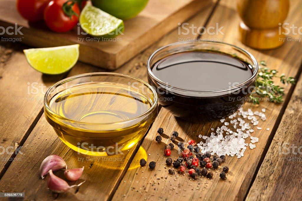 Vinagrette ingredients on rustic wood table stock photo