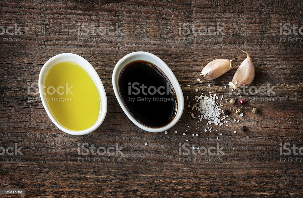 Vinaigrette dressing ingredients on vintage wood stock photo