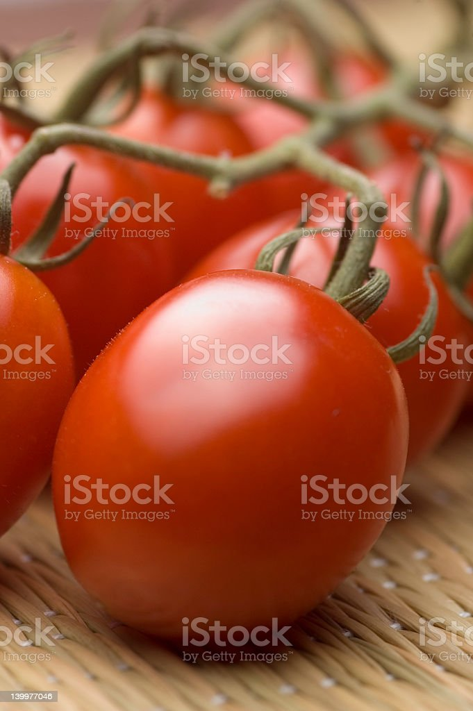 Vine ripened plum tomatoes royalty-free stock photo