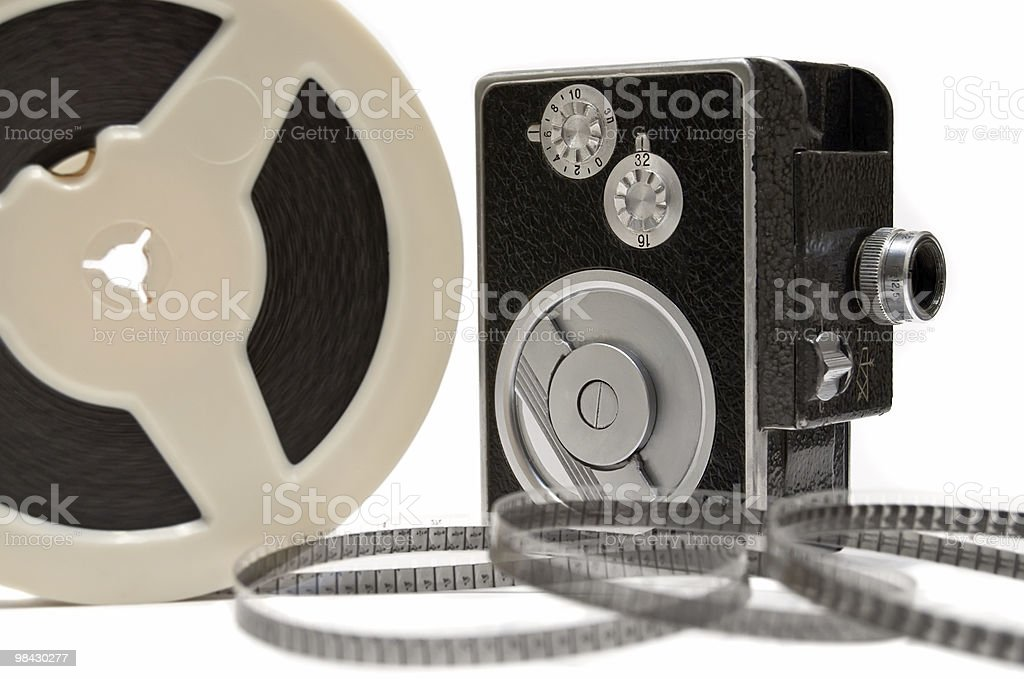Vintage 16mm home movie camera and film reel isolated stock photo