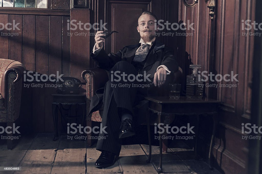 Vintage 1900 fashion man with beard and glasses. stock photo