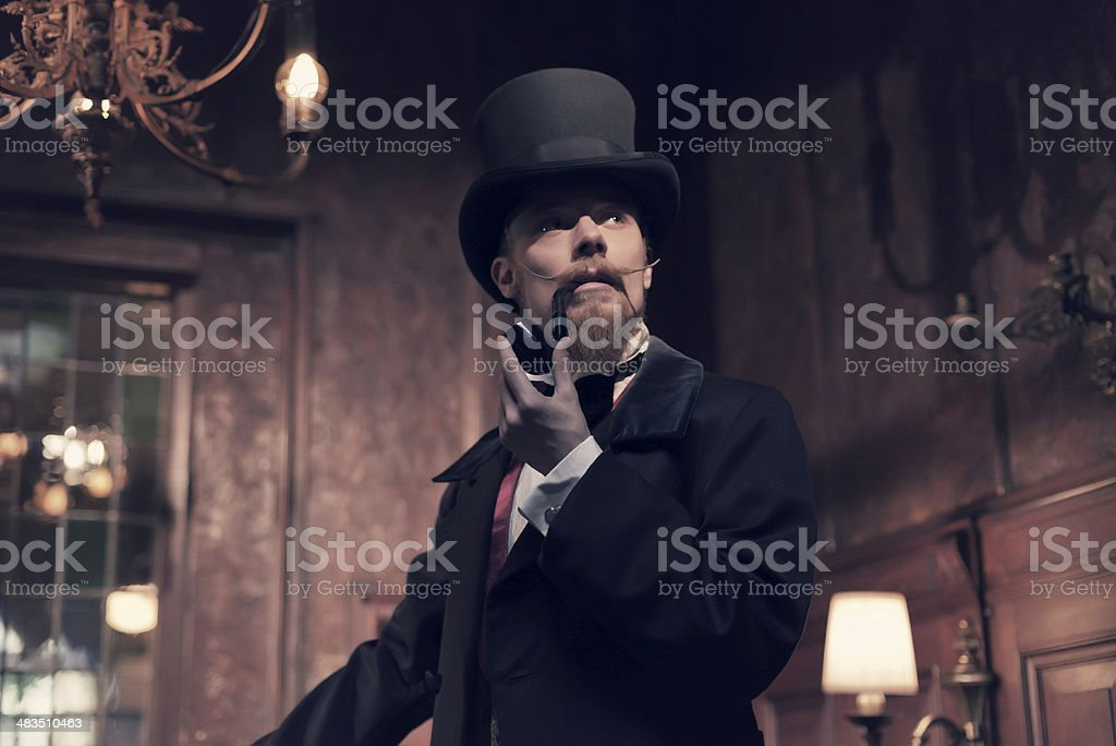 Vintage 1900 fashion man with beard. Smoking tobacco pipe. stock photo