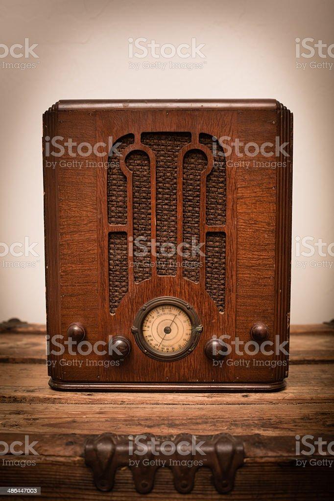 Vintage 1930's Art Deco Tube Radio Sitting on Wood Trunk royalty-free stock photo