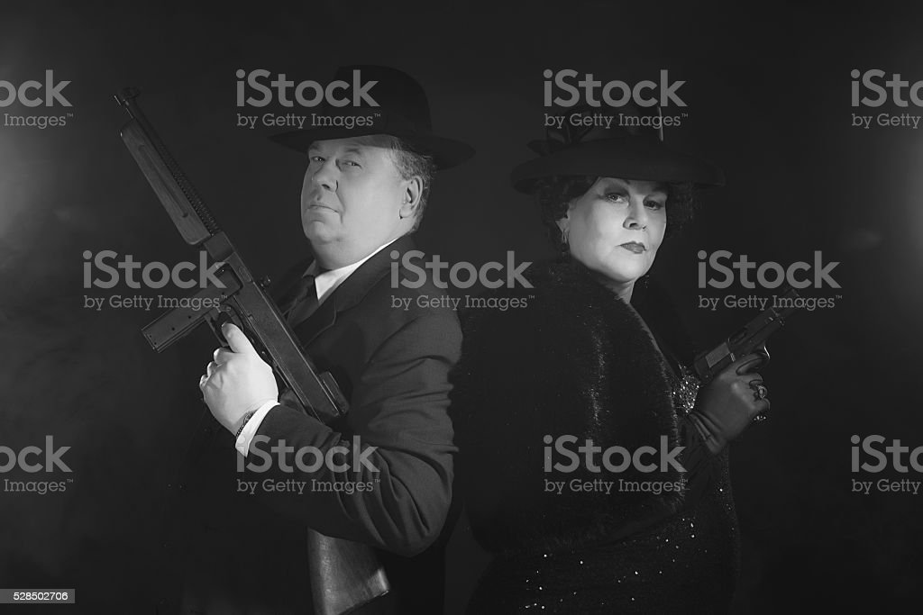 Vintage 1940s gangster couple. Black and white classic portrait. stock photo