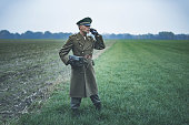 Vintage 1940s military officer calling with field phone.