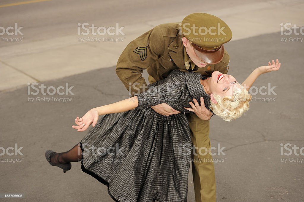 Vintage 1940's US Soldier Preparing To Kiss His Girl royalty-free stock photo