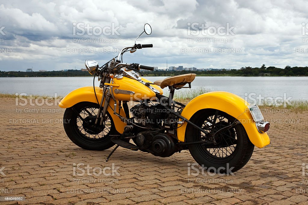 Vintage 1947 Yellow Harley-Davidson Knucklehead on Cloudy Weather stock photo