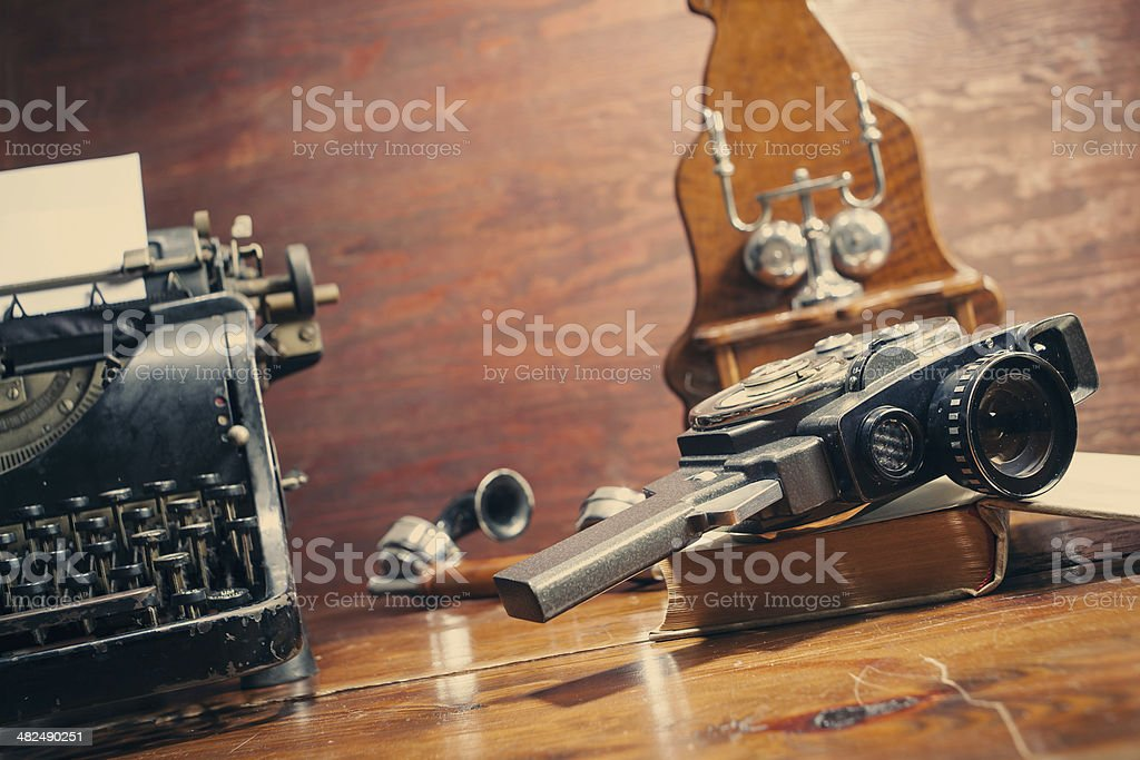 Vintage 8mm camera and typewriter stock photo