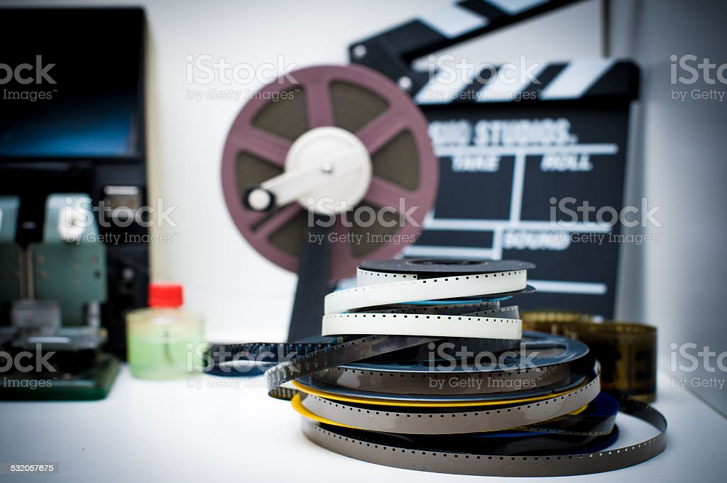 Vintage 8mm movie editing desktop with reels and clapper stock photo