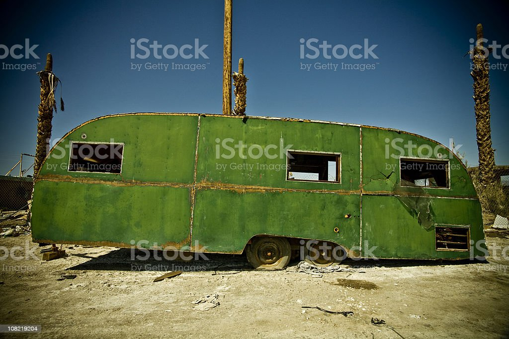 Vintage Abandoned Mobile Home in Middle of the Desert royalty-free stock photo