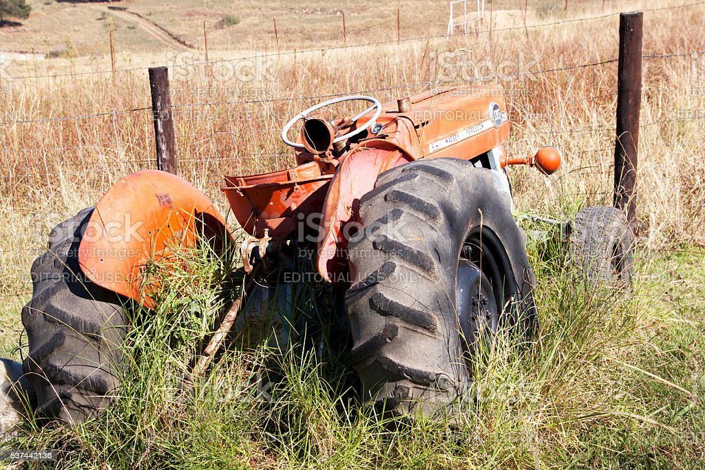 Vintage Abandoned Red Massey Ferguson 135 Tractor on Farm stock photo
