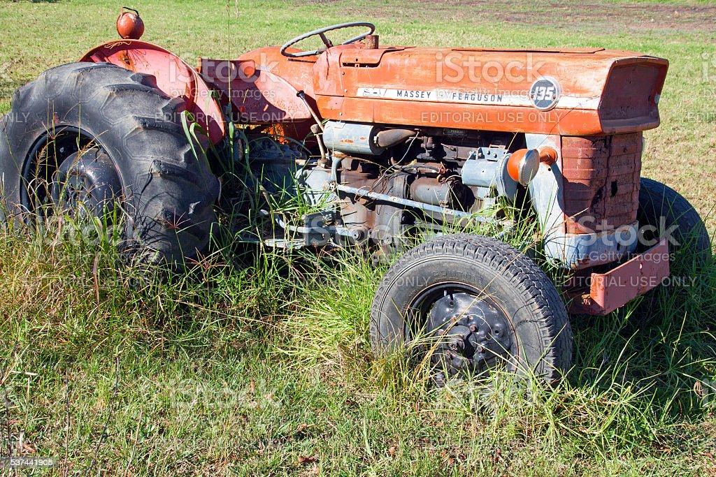 Vintage Abandoned Red Massey Ferguson 135 Tractor stock photo