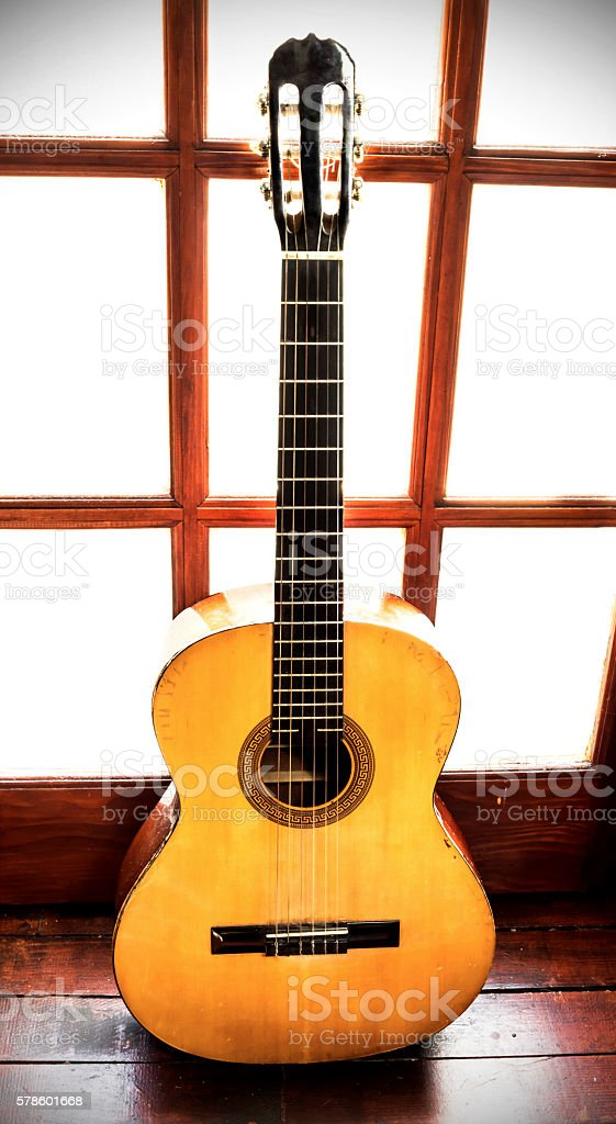Vintage acoustic guitar stock photo
