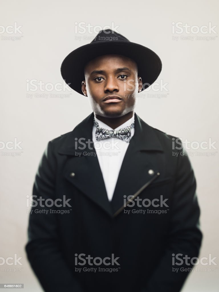 Vintage african american man wearing black suit and hat stock photo