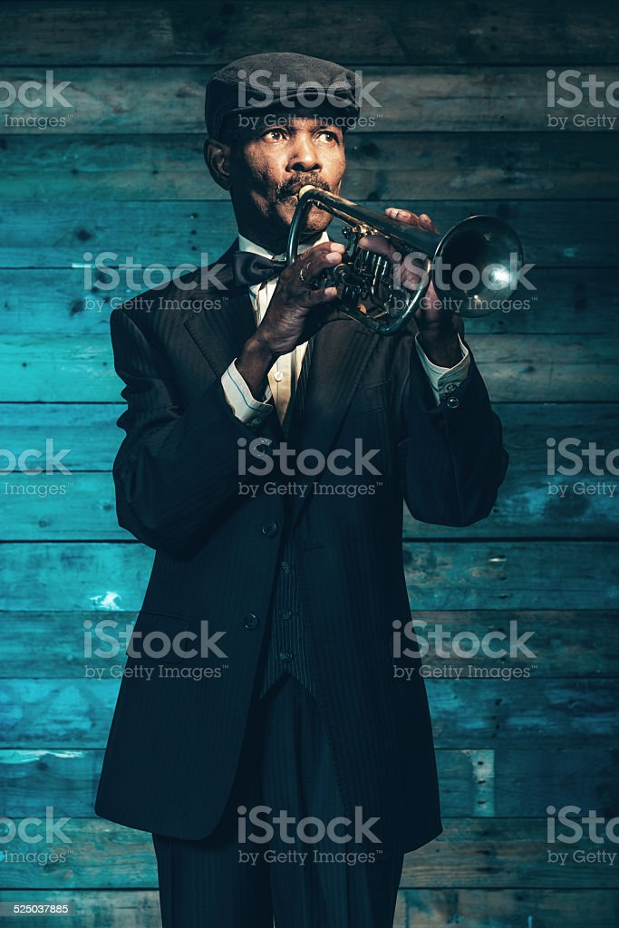 Vintage african american senior jazz musician with trumpet. stock photo