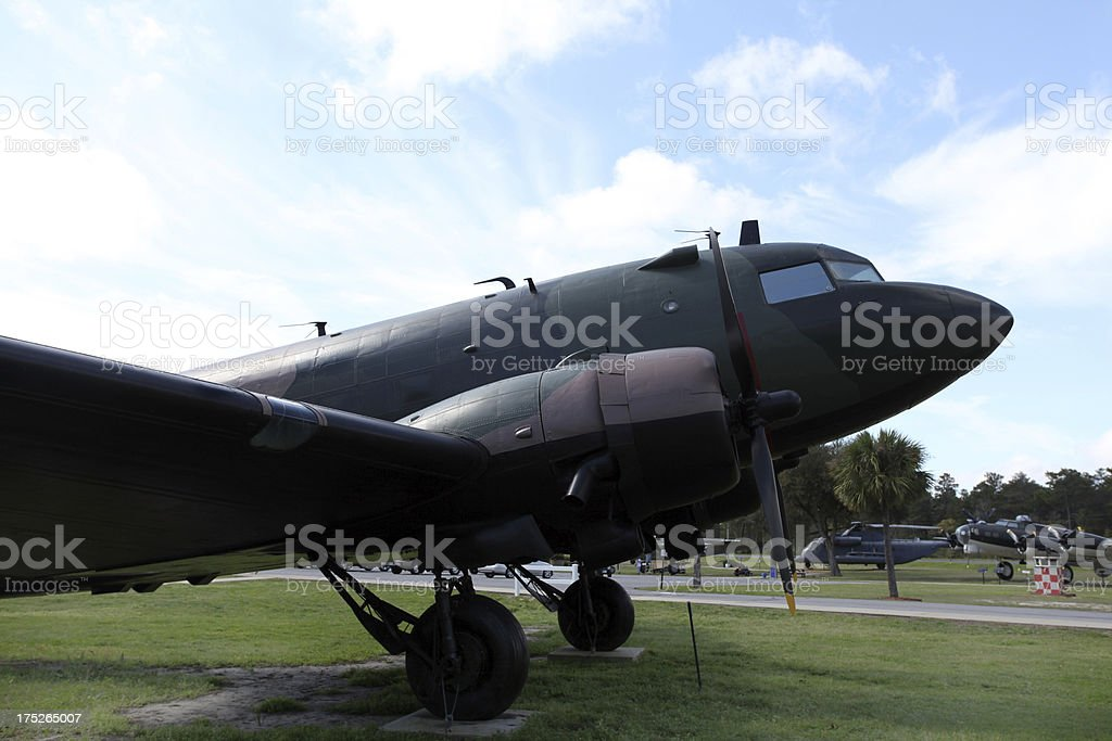 Vintage aircraft on outdoor display.  Blue sky.  copy space. royalty-free stock photo