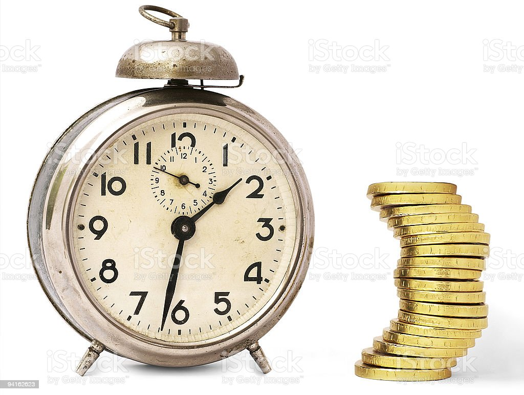 Vintage alarm clock and golden coins over white royalty-free stock photo