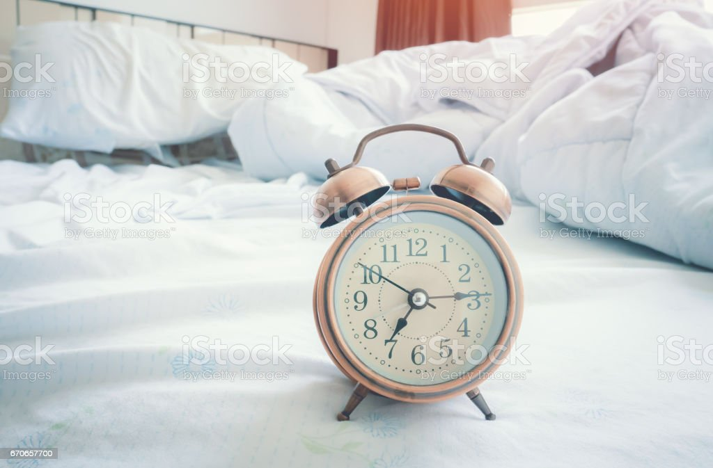 Vintage alarm clock in bedroom stock photo