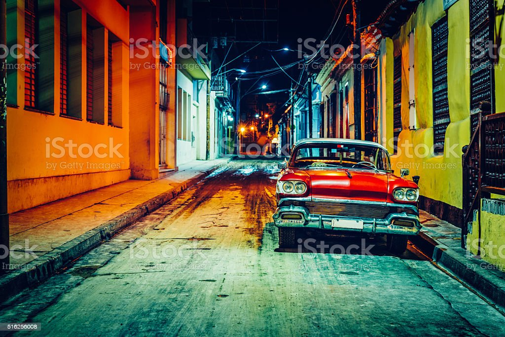 Vintage American car (taxi) parked in Santiago de Cuba stock photo