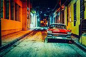 Vintage American car (taxi) parked in Santiago de Cuba