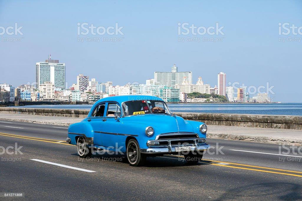 Vintage American Car Speeding along the Malecon in Havana, Cuba stock photo