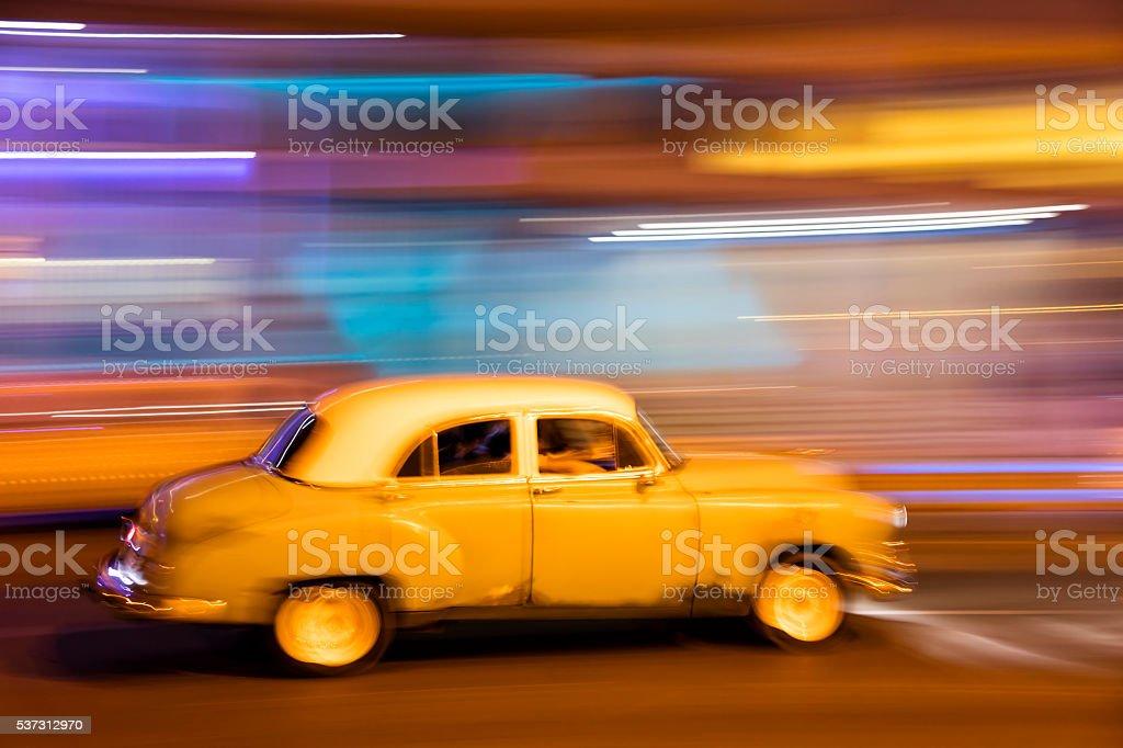 Vintage American Car Speeding at Night, Havana, Cuba stock photo