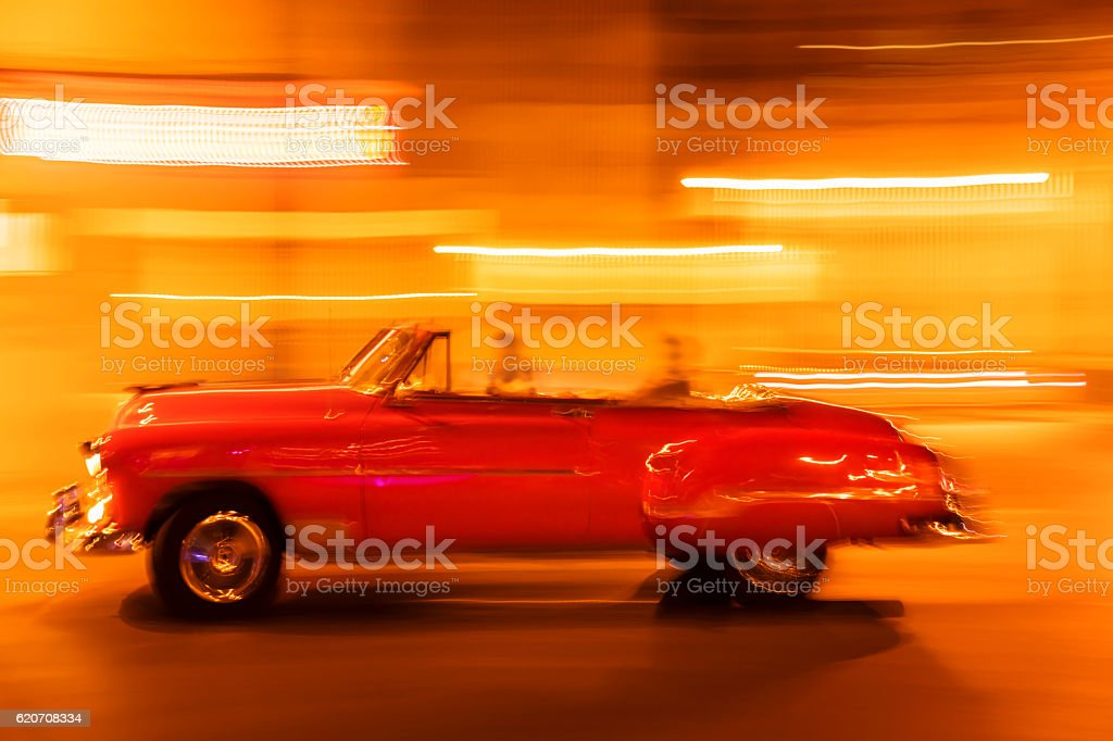 Vintage American car with tourists in Havana, Cuba stock photo
