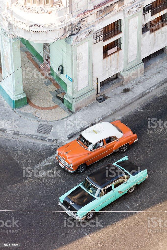 Vintage American Cars Driving in Havana, Cuba stock photo