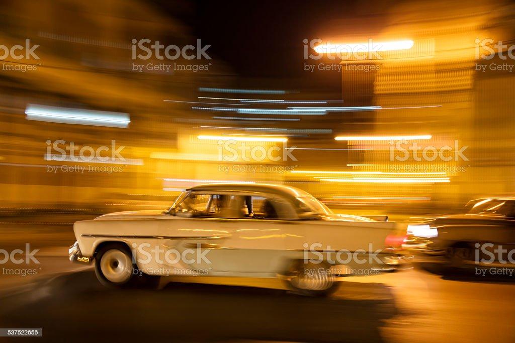 Vintage American Cars Speeding at Night, Havana, Cuba stock photo