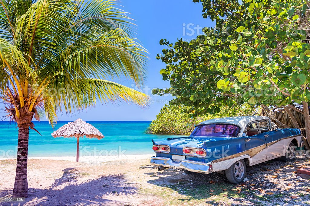 Vintage american oldtimer car parked on a beach in Cuba stock photo