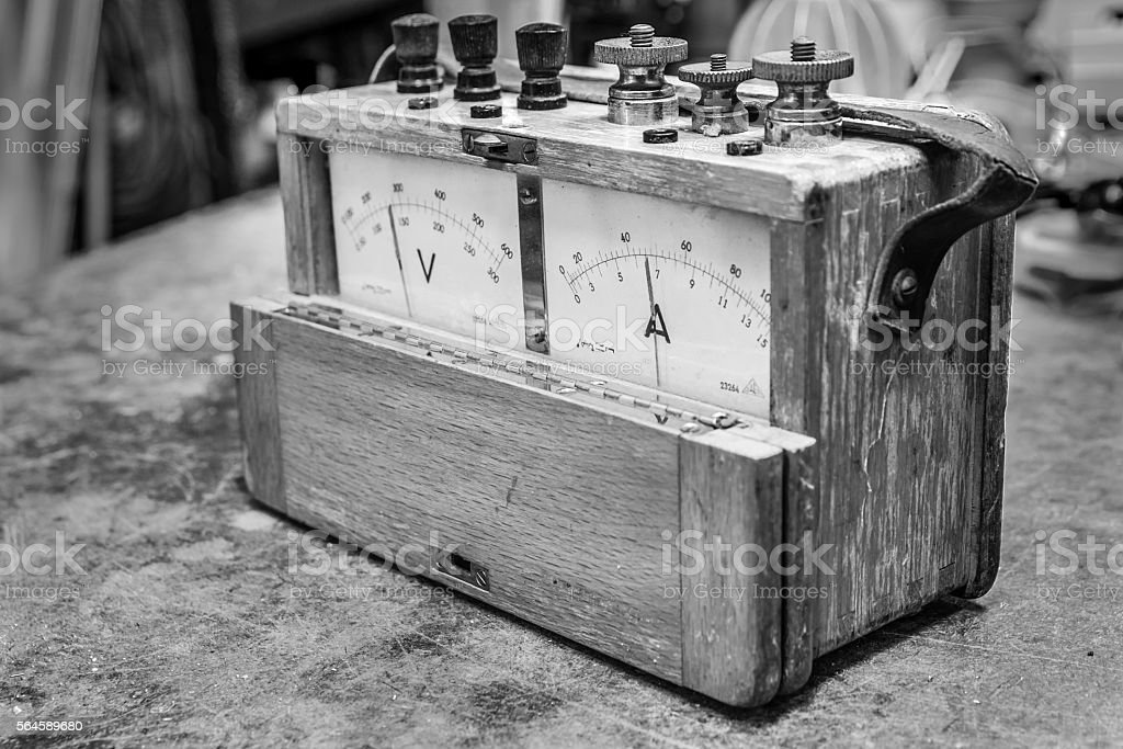 Vintage analog wooden electric meter on the old table test stock photo