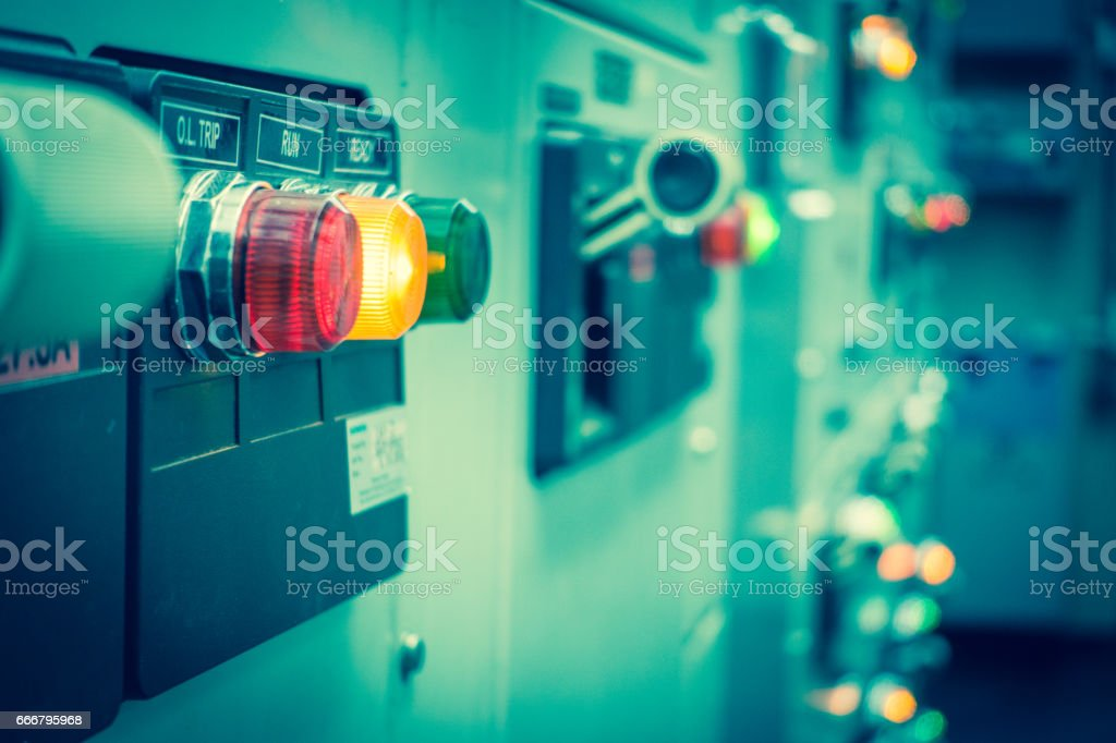 Vintage and blur tone of Electrical switchgear room,Industrial electrical switch panel on plant  and process control with grainy style. stock photo