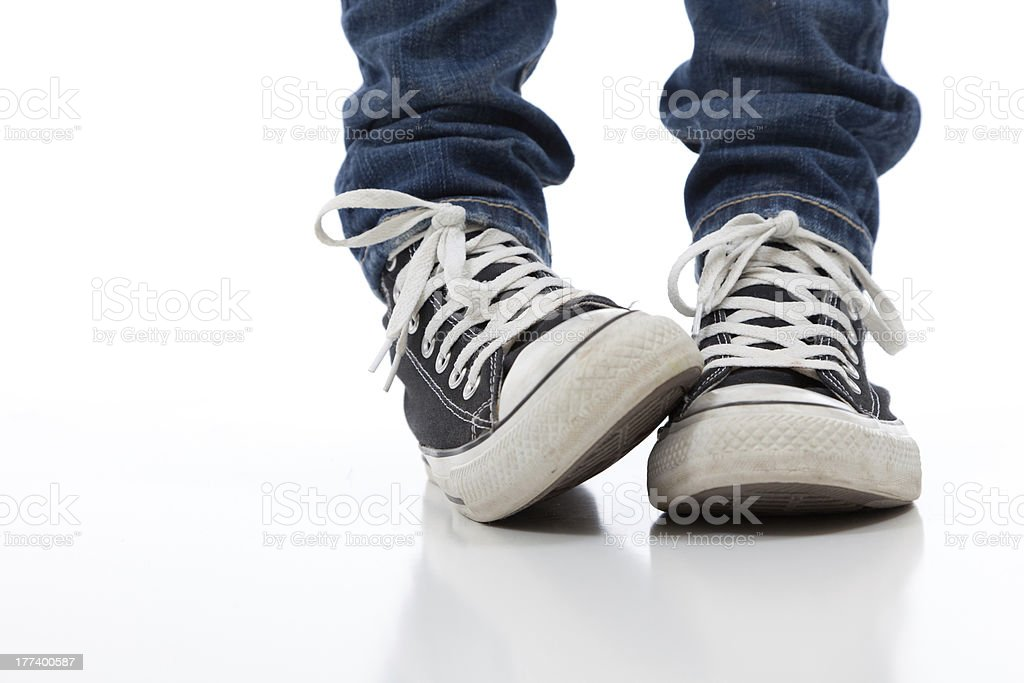 Vintage, antique athletic shoes on a white background stock photo