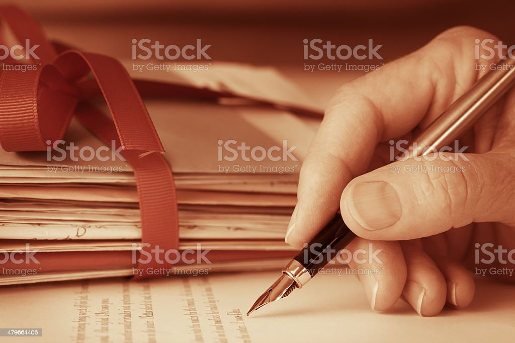 Vintage Antique Hand with Fountain Pen Writing Letters Closeup stock photo