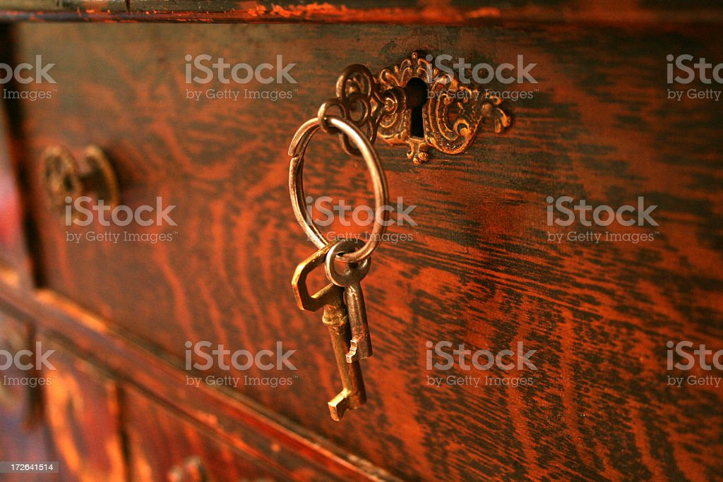 Vintage antique keys on the lock of a red wooden box stock photo