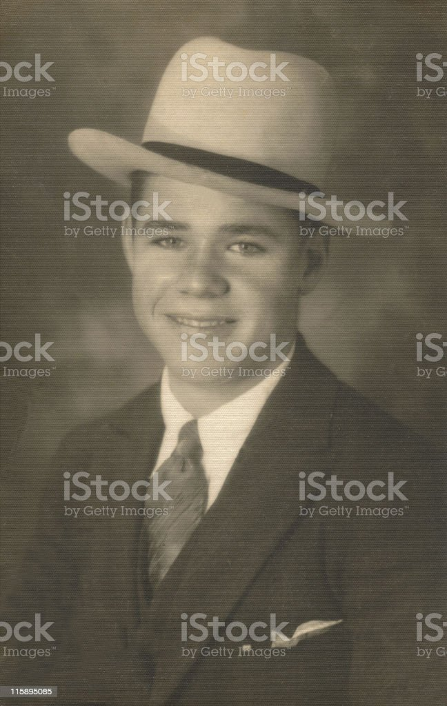 Vintage antique portrait photograph. Young man 1920's. Suit and hat. royalty-free stock photo