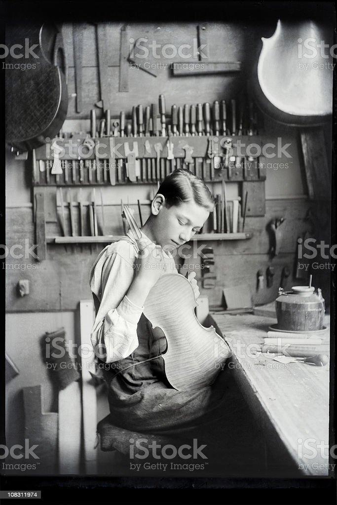 Vintage Apprentice Violin Maker stock photo