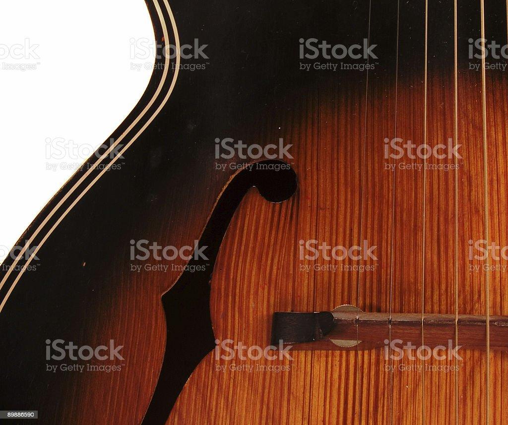 Vintage Archtop F buracos detalhe da guitarra acústica foto royalty-free