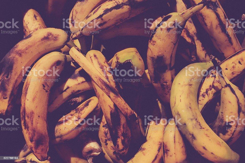 vintage background of bruised bananas. stock photo