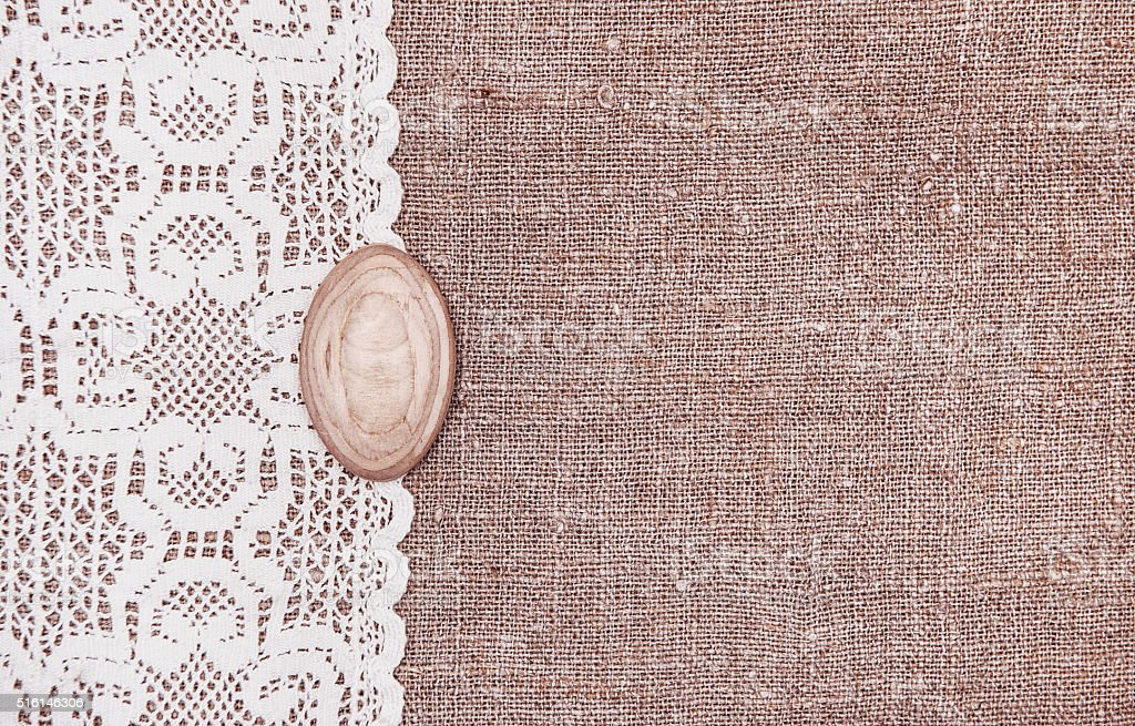 Vintage background with lace on the burlap stock photo