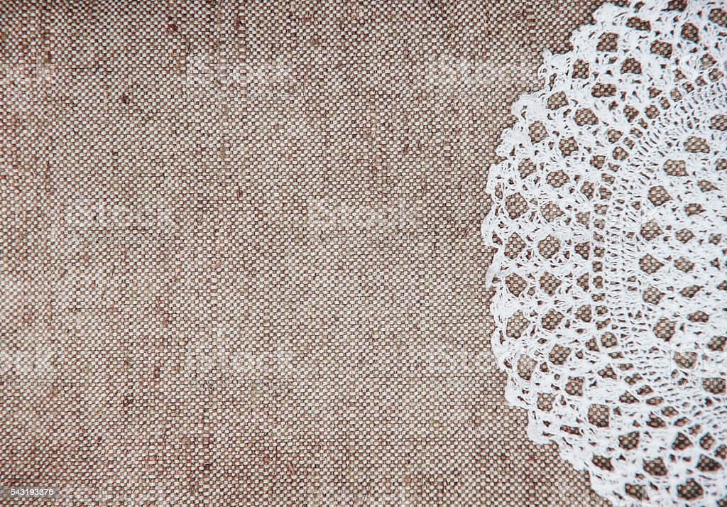 Vintage background with lacy on linen burlap texture stock photo