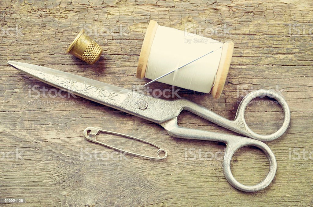Vintage background with sewing tools.Sewing kit. stock photo