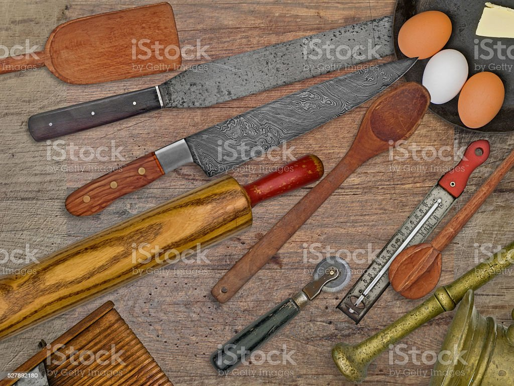 vintage bakery shop utensils over wooden table stock photo