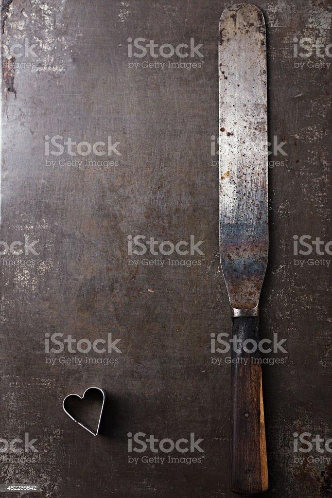 Vintage  Baking utensils - spatula and heart shape cutter stock photo