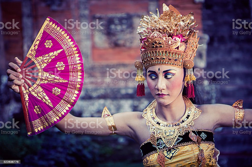 Vintage Bali performing dancer in a temple with fan stock photo